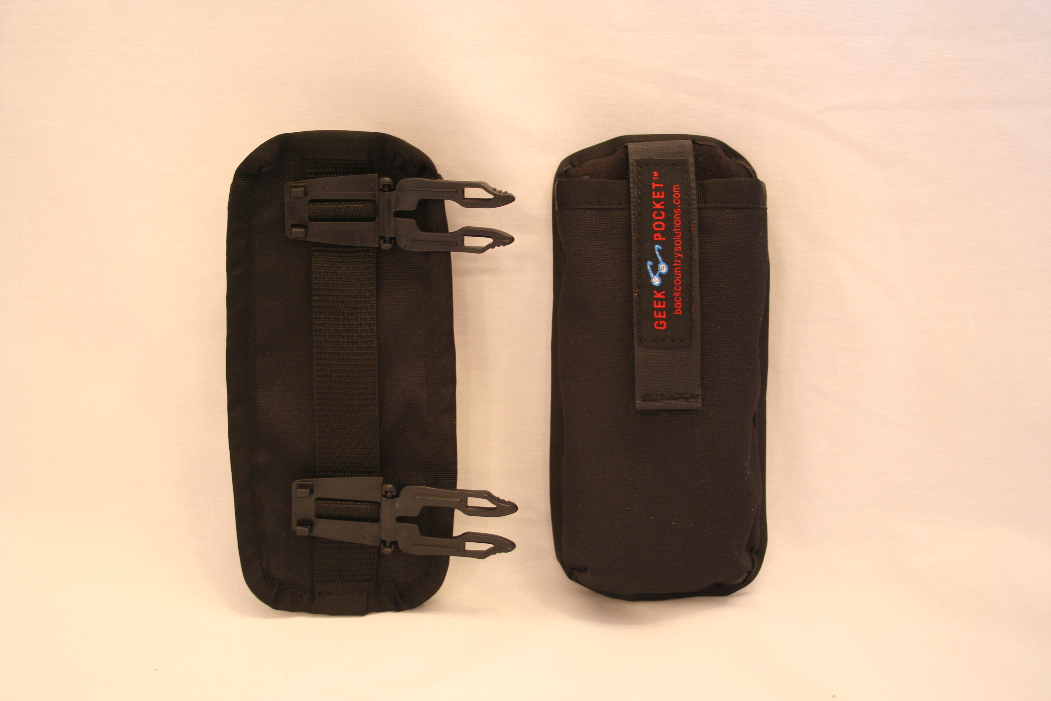 Front and Back - clips fold over and sandwich webbing.   Behind top clip is a loop for inserting  a belt