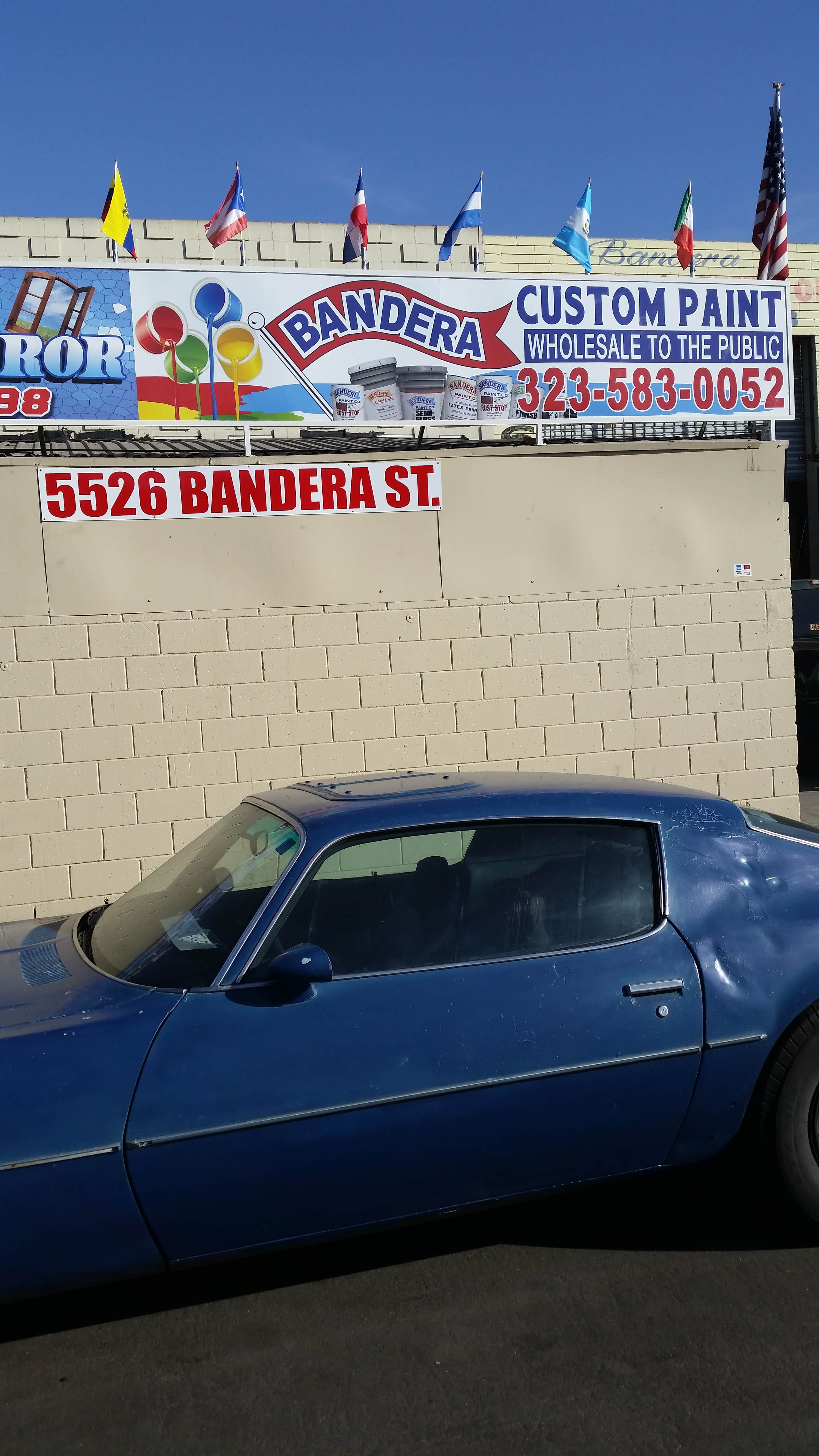 Blue Car and Outdoor Signage