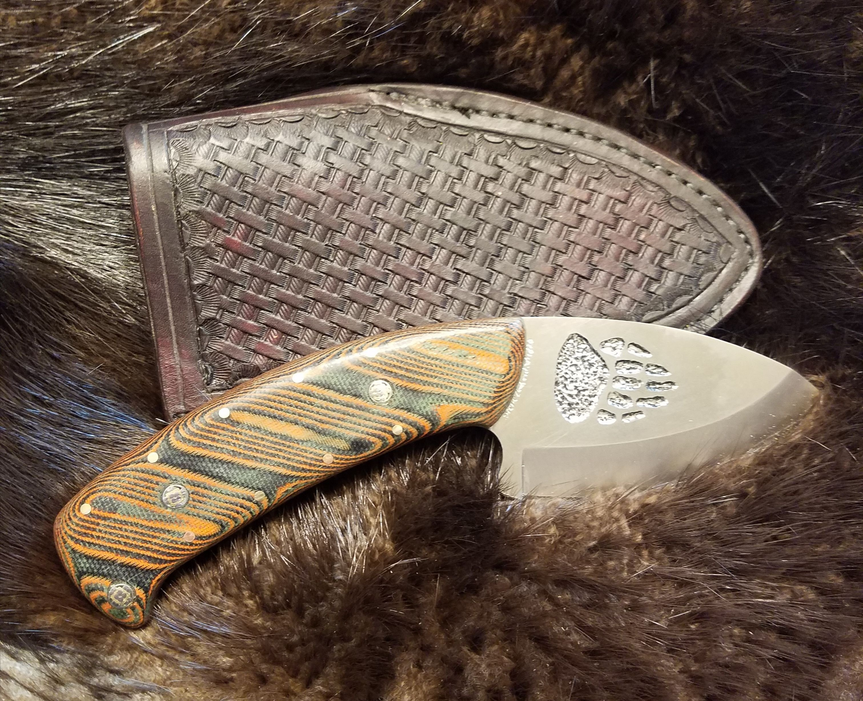 Grizzly Paw Engraved Skinner With Orange Dewcarta Handle, Hand Tooled, Hand Stitched Leather Sheath,   $180.00