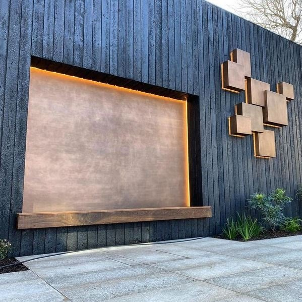 Metal coating projects. Bronze finished back lit wall sculpture and feature wall panel