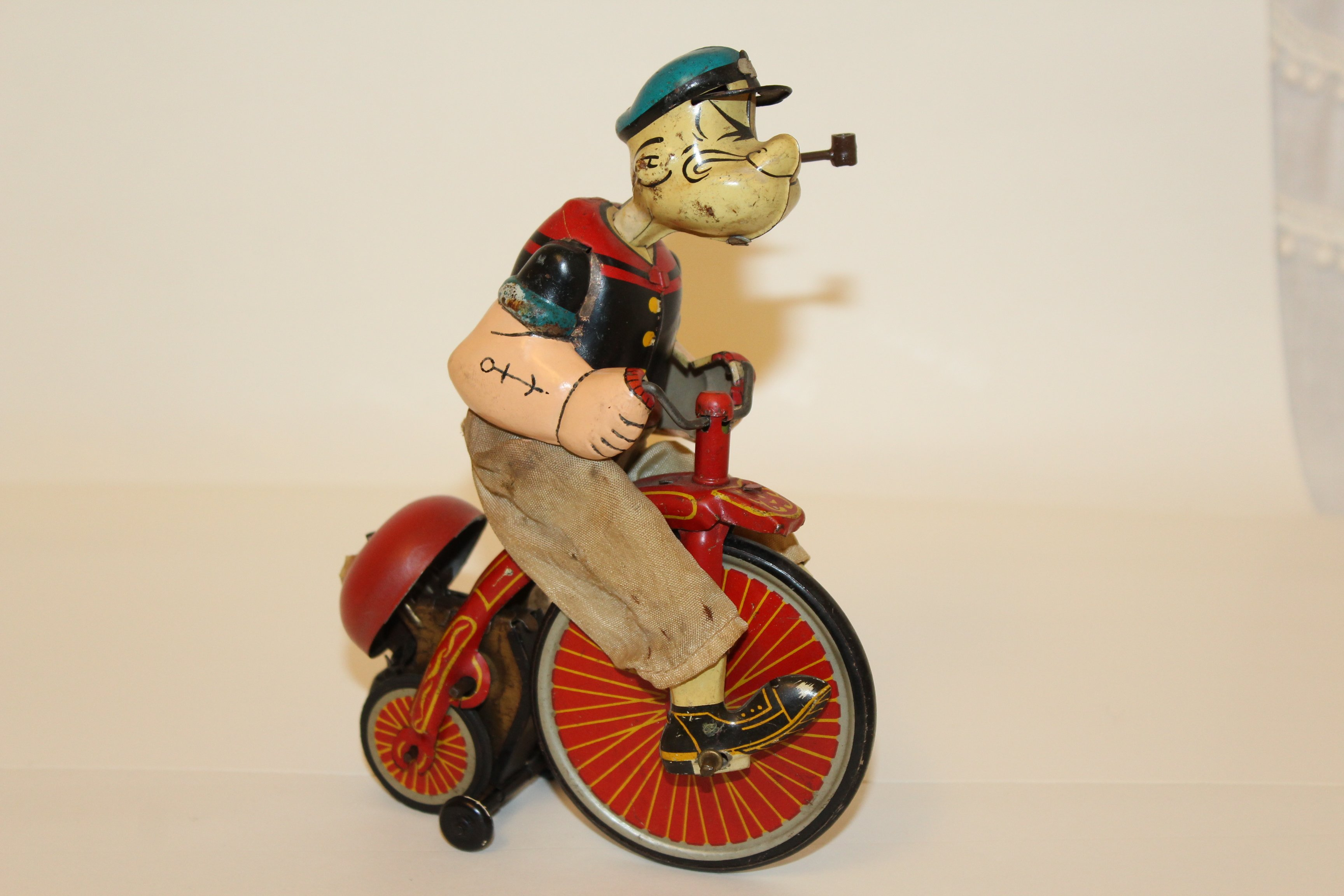 https://0201.nccdn.net/1_2/000/000/08a/7b8/Popeye-on-Tricycle.JPG