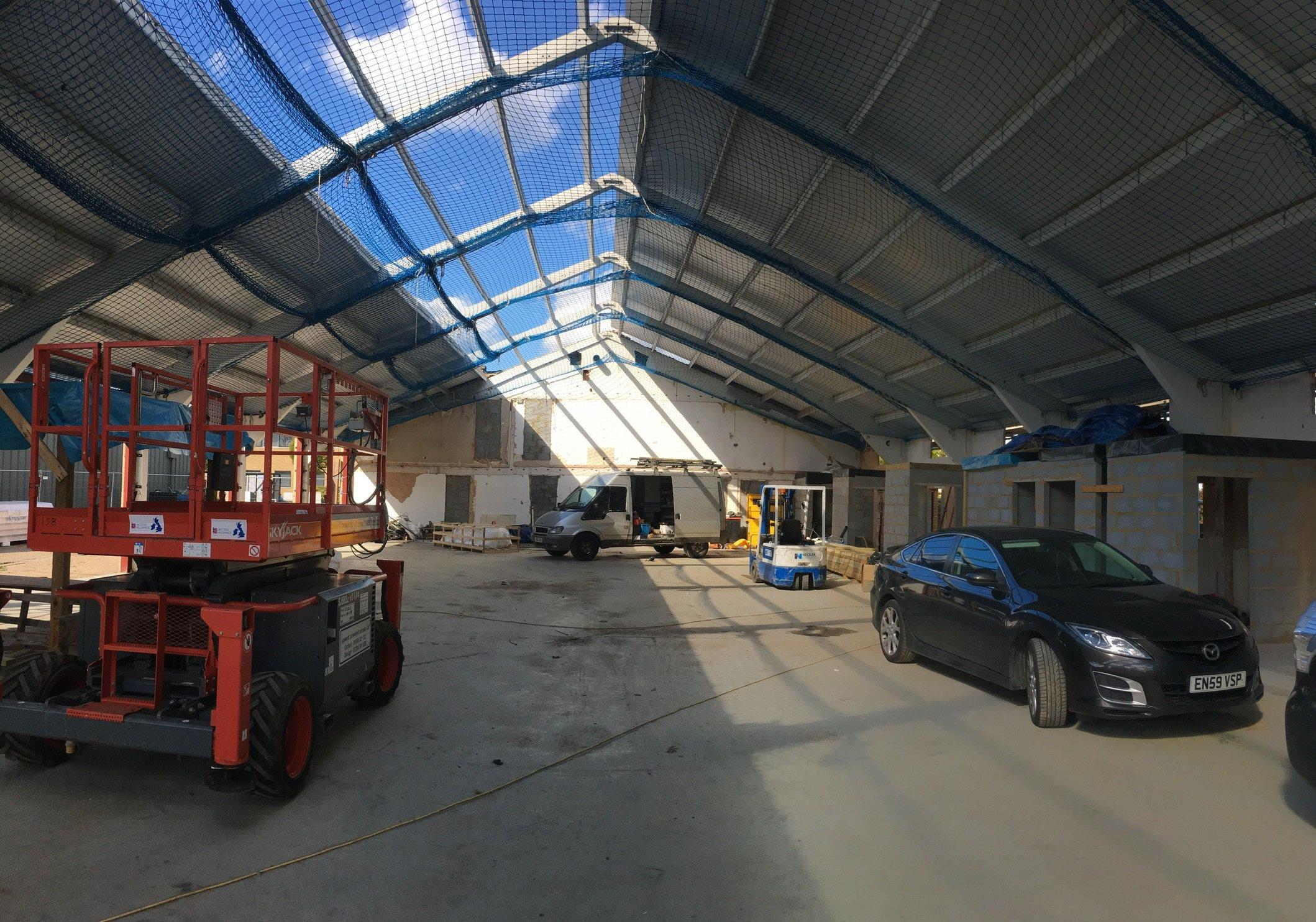 KS1000 roof going on original concrete portal frame