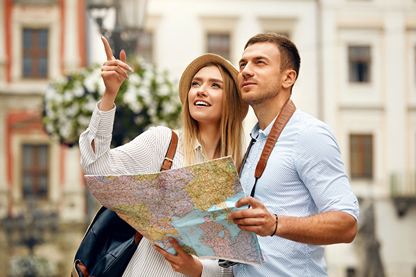 Couple With Map On Travel Vacations