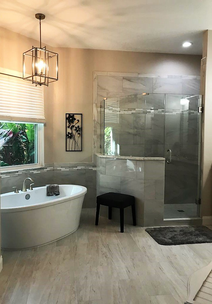 Timeless bathroom featuring stand alone tub and large separate walk-in shower.