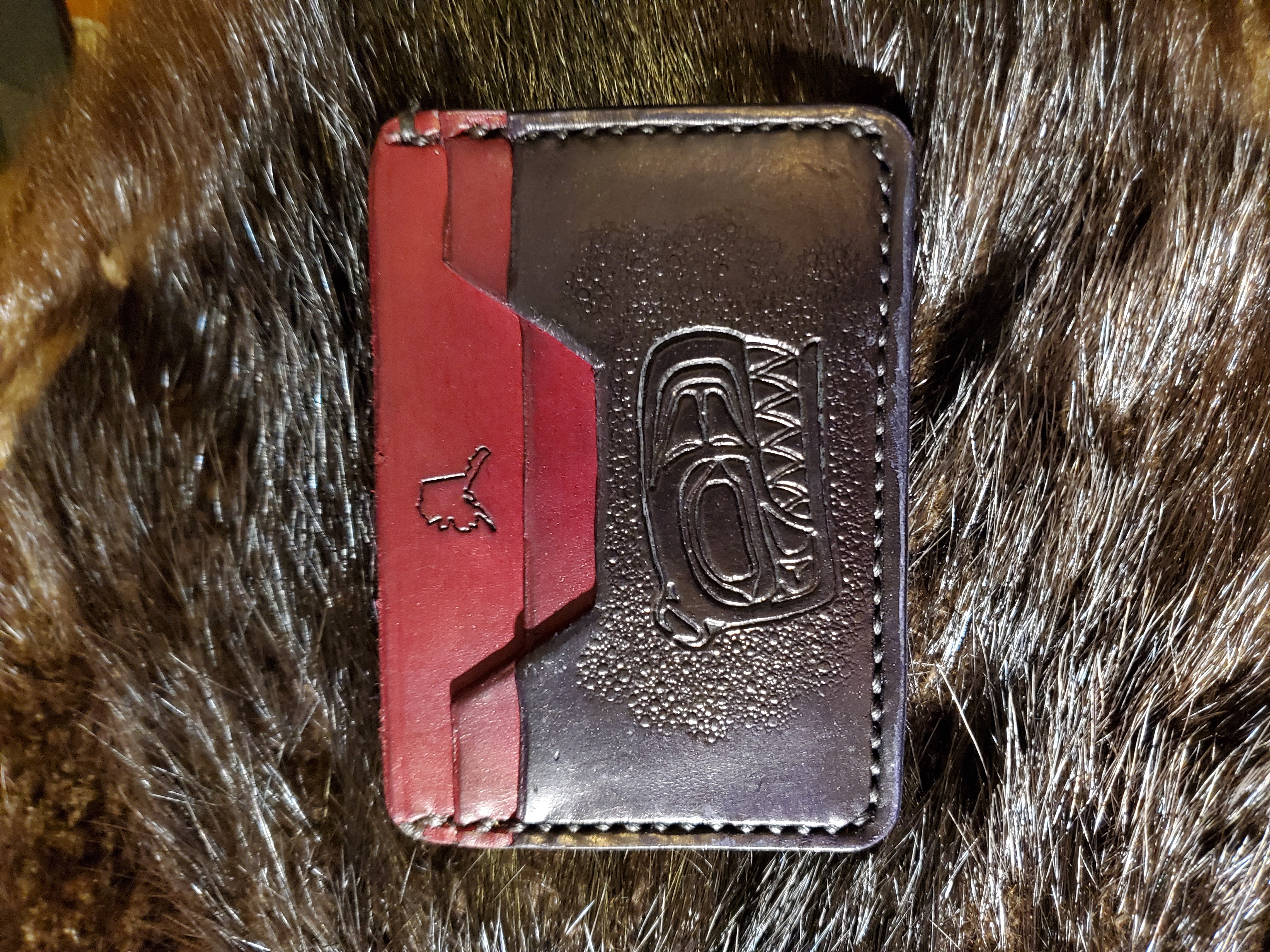 (Front)  3 pocket minimalist wallet, Native Killer Whale, hand stitched and tooled,  $65.00