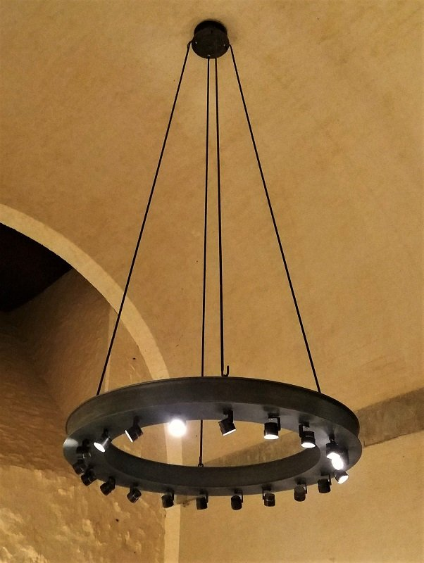 Thermal metal finishes. Pewter finished chandeliers in the  Tower of London, White Tower dungeons.