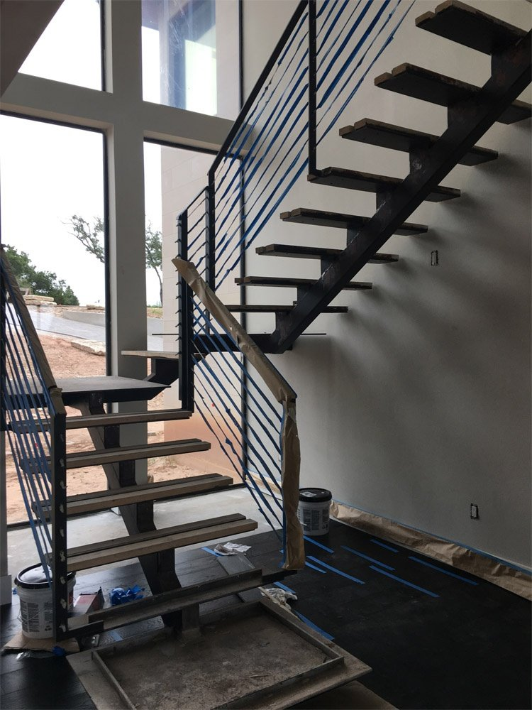https://0201.nccdn.net/1_2/000/000/08f/1ba/Steel-Stairs--Hand-Rails-750x1000.jpg