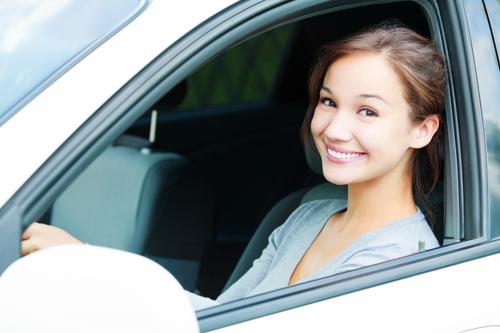A woman in a car||||