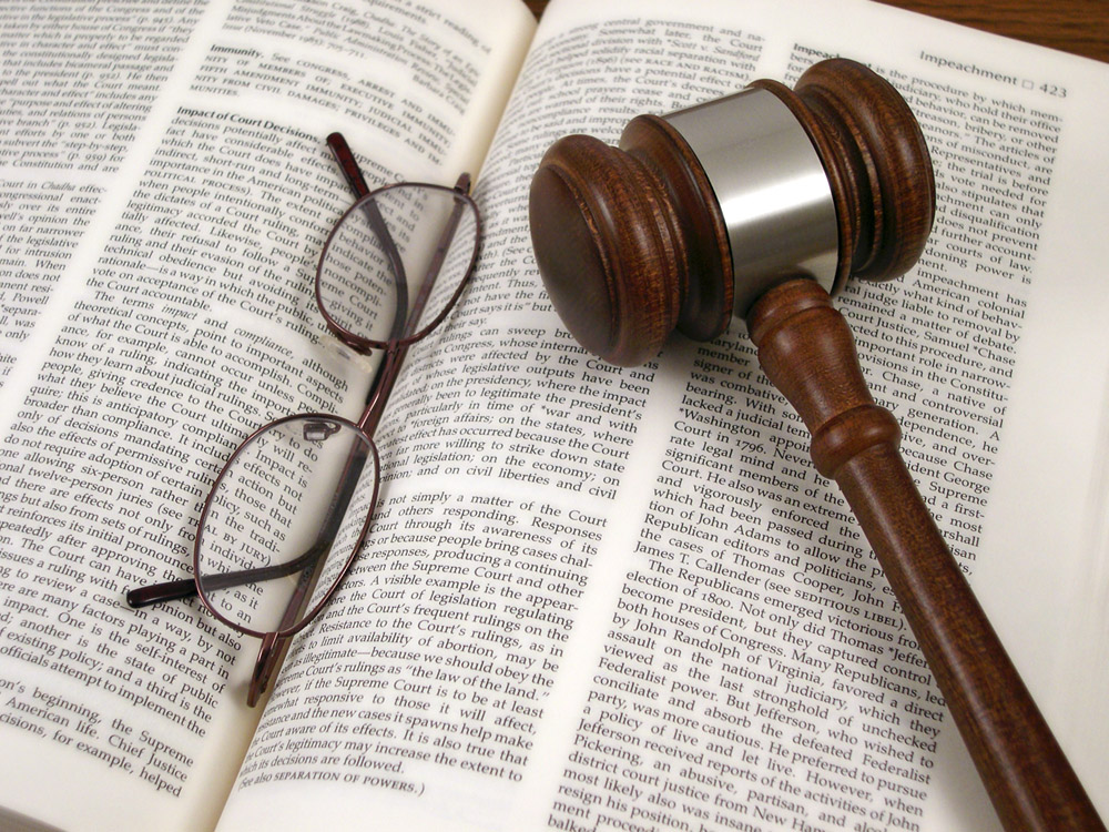 Gavel and glasses on open book||||