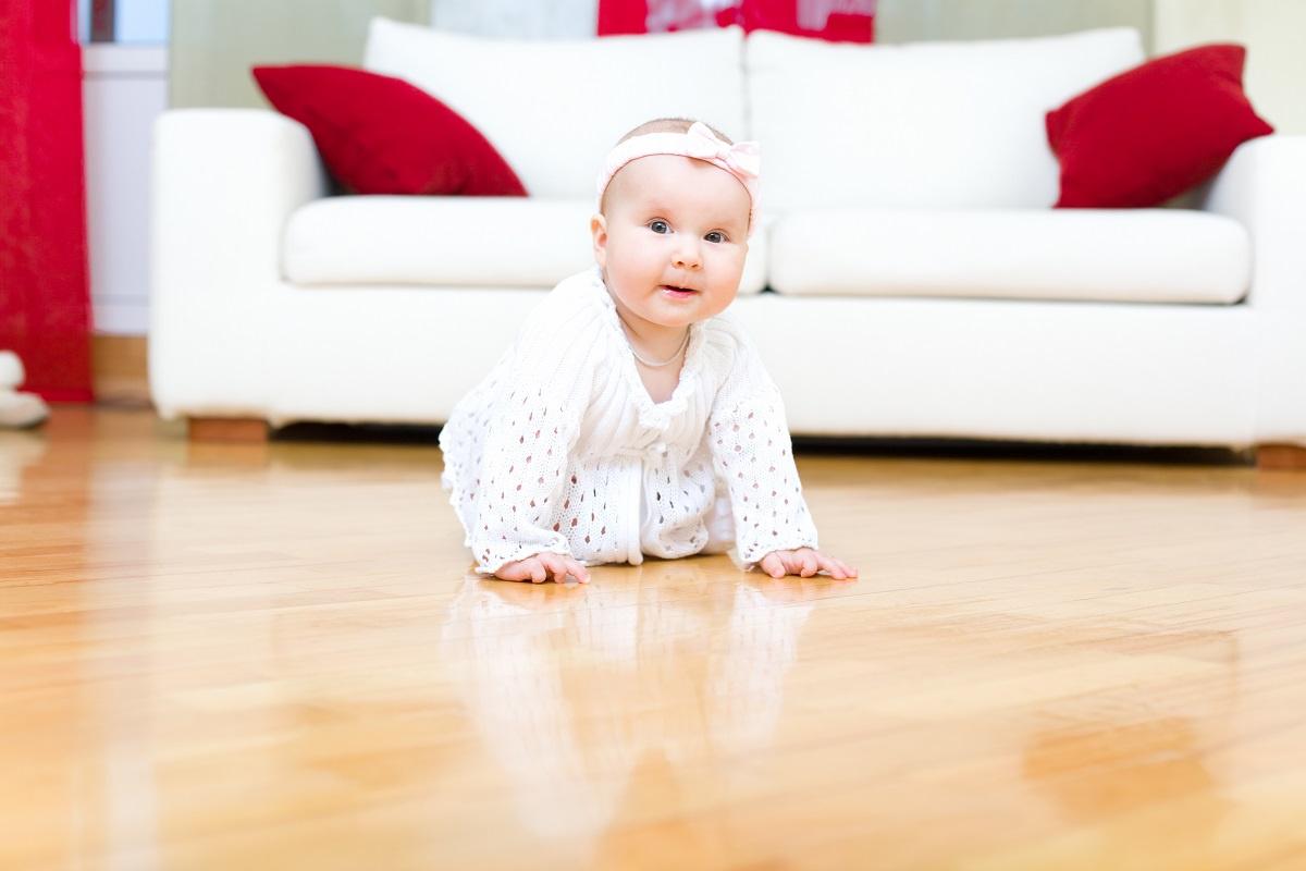 Baby crawling on hardwood