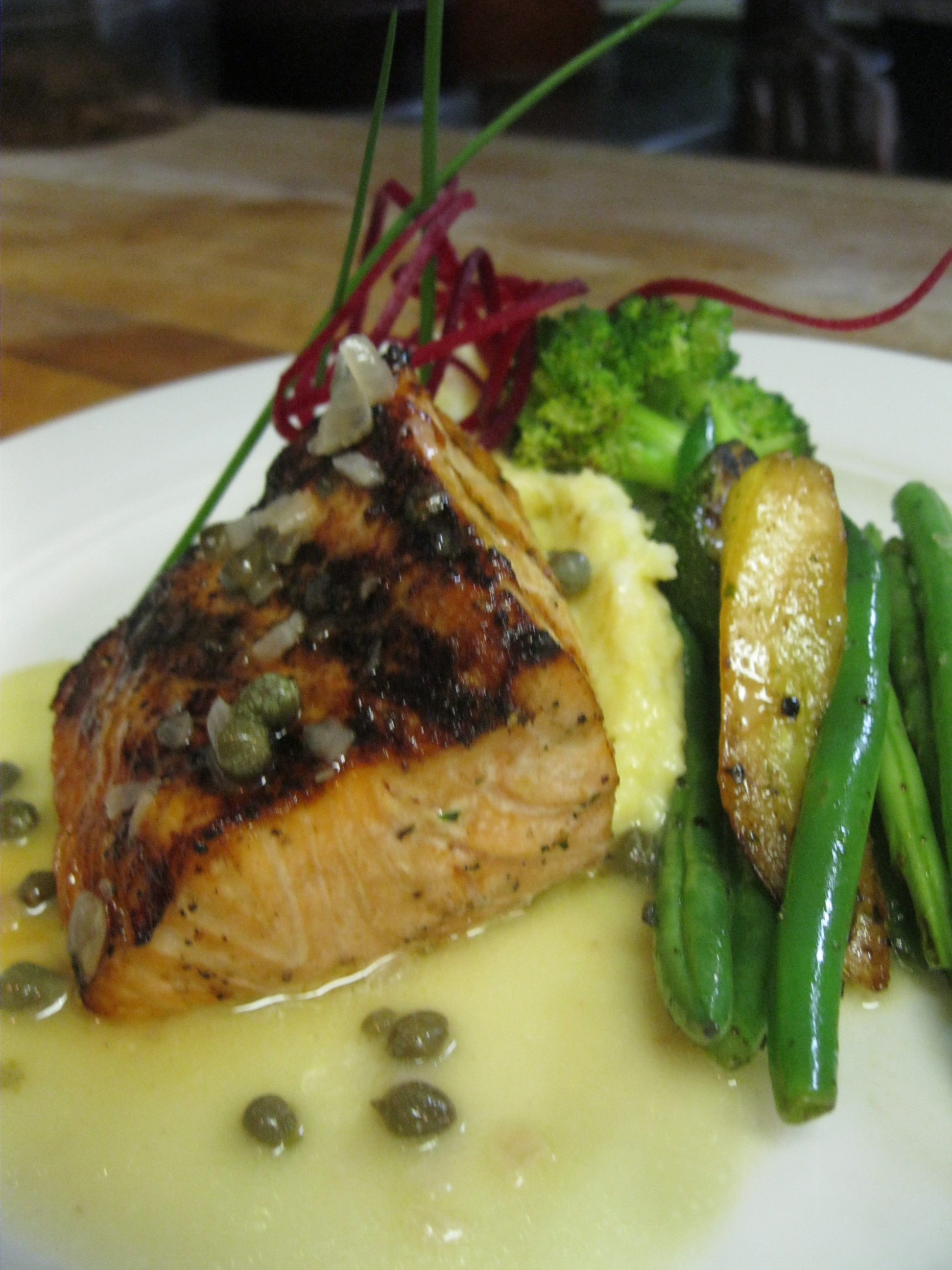 Grilled Wester Ross salmon with a lemon caper burro bianco