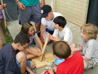 Kids Playing Catapult