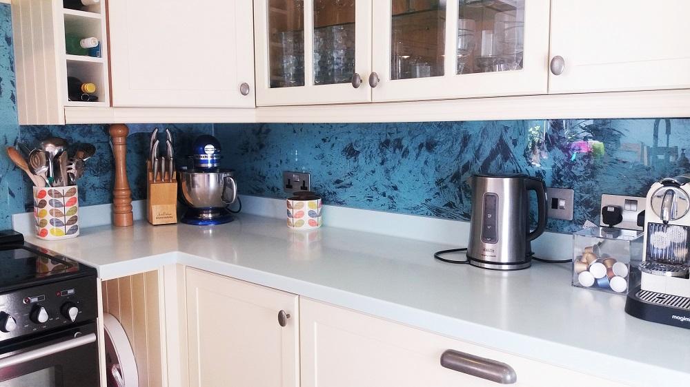 Custom paint finishes on kitchen splashback by Artistic Metals.