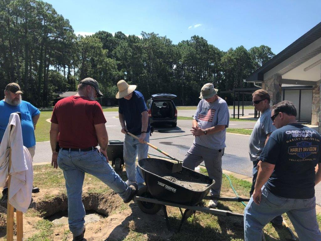 Men working on flag pole installation