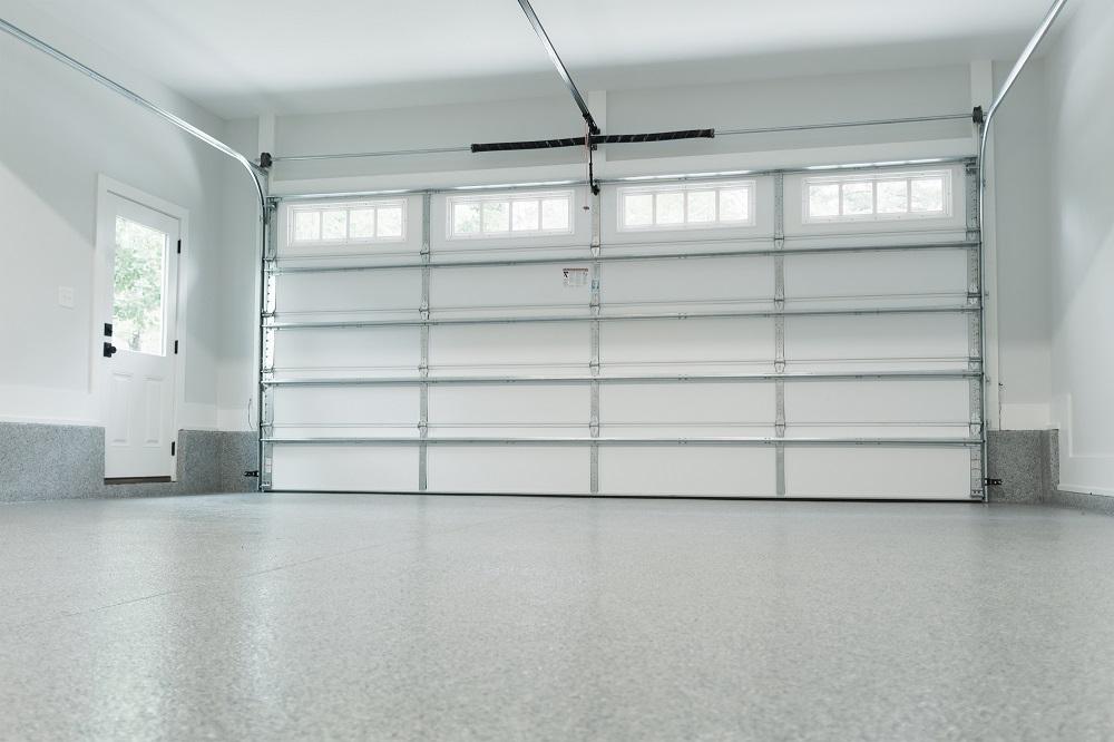 Inside Empty White Garage with White Garage Door