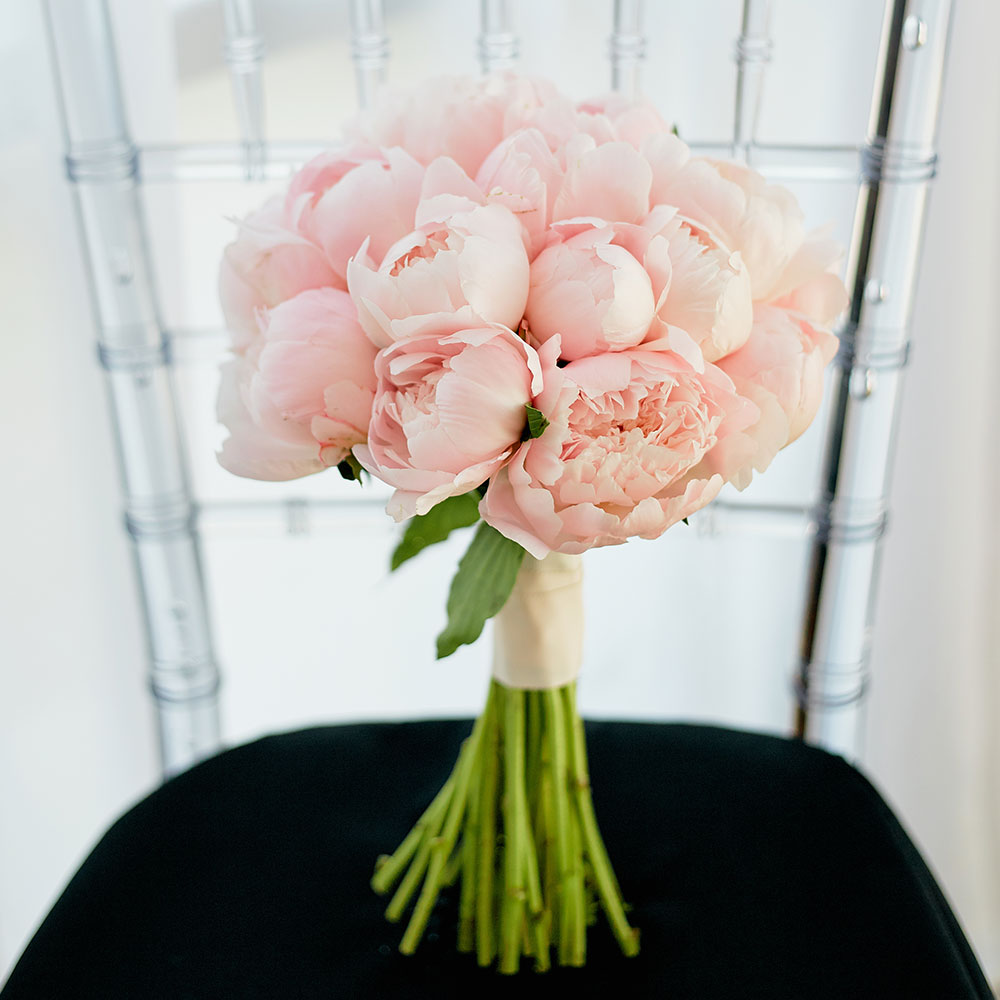 Bridal Bouquet Of Pink Peonies On Chair