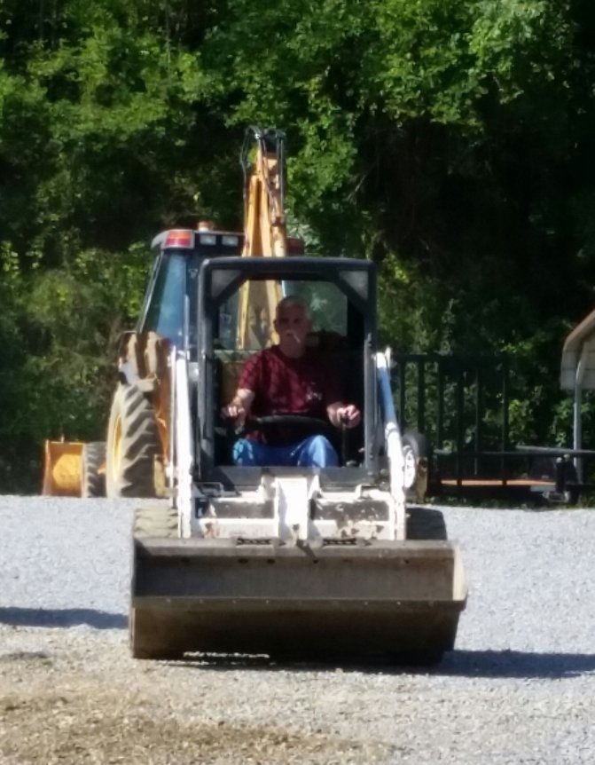 Chuck Kimmen on our Bobcat