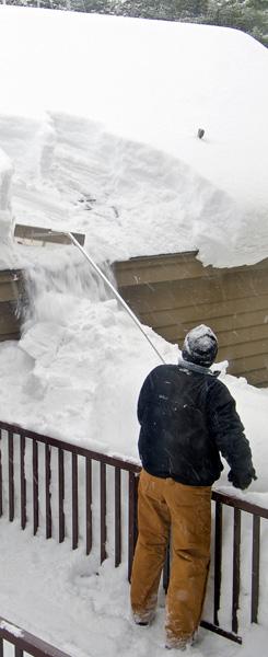Man using a snow rake
