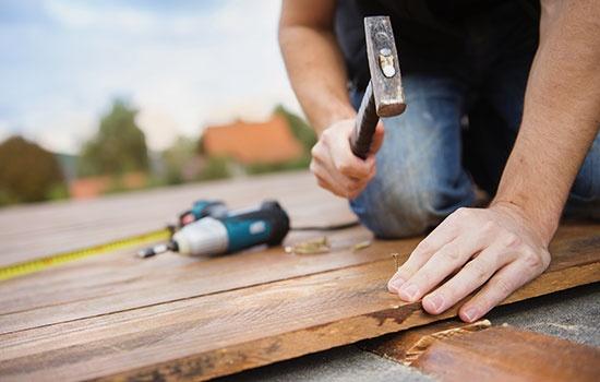 Carpenter Installing Wooden Flooring