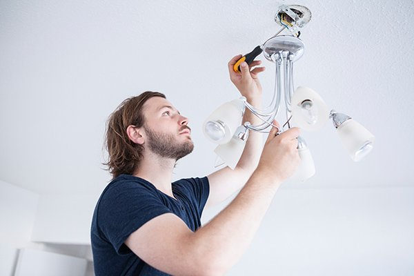 Person fixing lamp