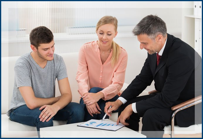 Financial Advisor Showing Graph To Couple