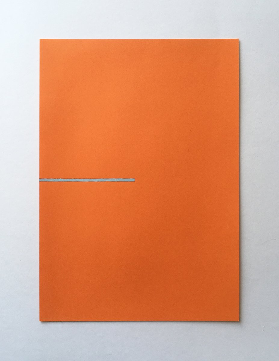 An orange piece of paper with a straight line of light blue paint halfway up.