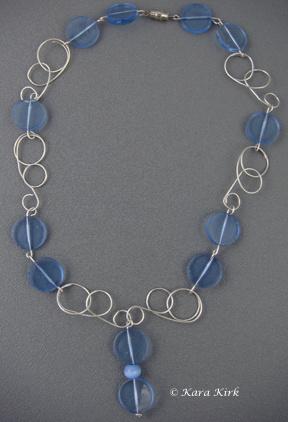 https://0201.nccdn.net/1_2/000/000/0a2/785/SS-Circle---Blue-Bead-Necklace-2-4x6-288x422.jpg