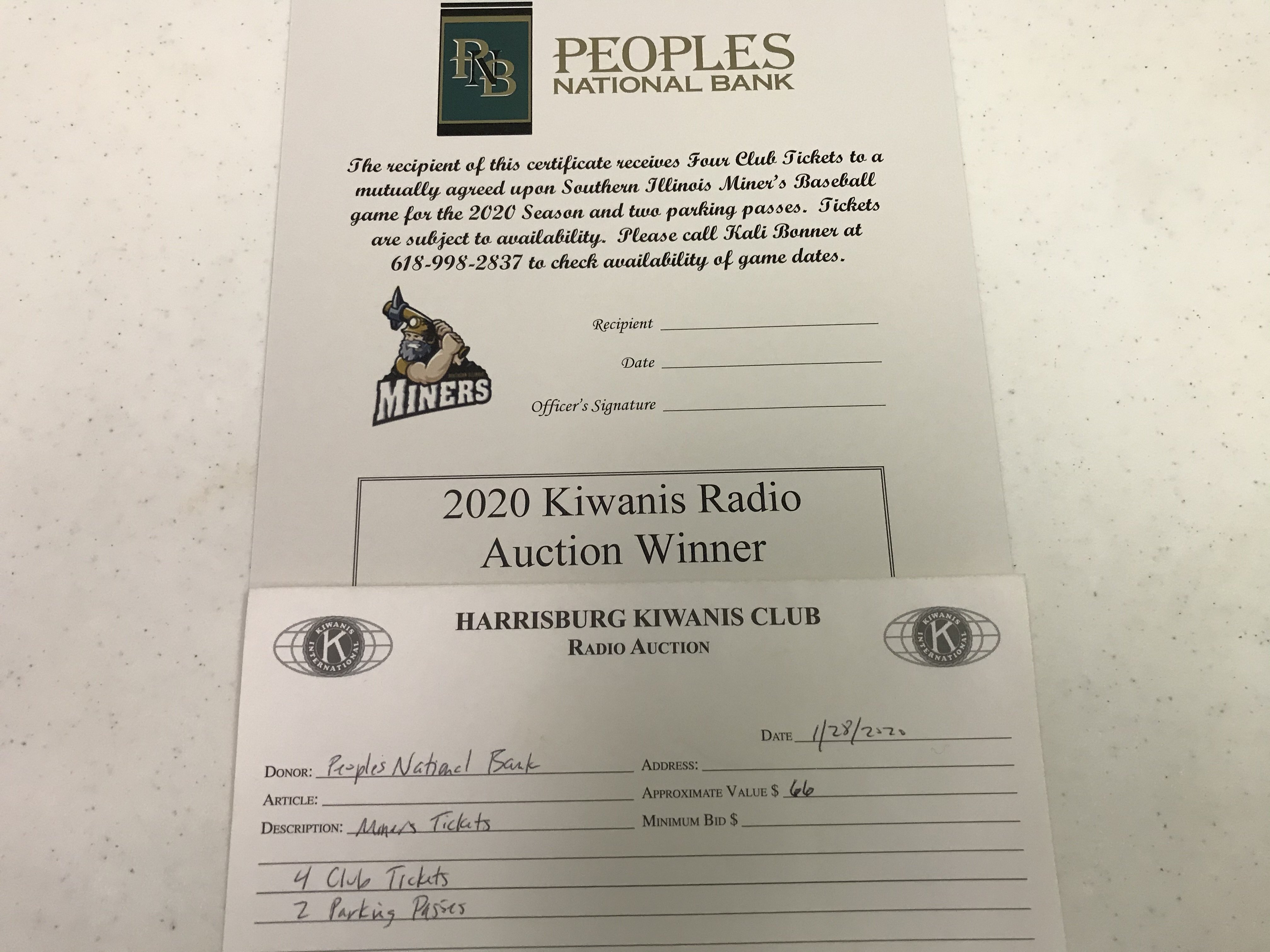 Item 217 - Peoples National Bank Miners Tickets - 4 Club Level Seats and 2 Parking Passes