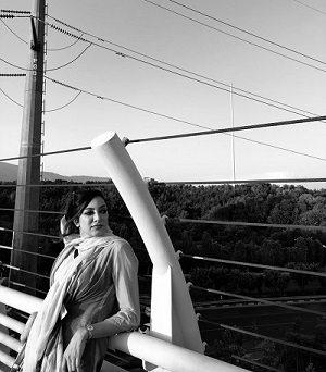 Woman Leaning on Cable Railing
