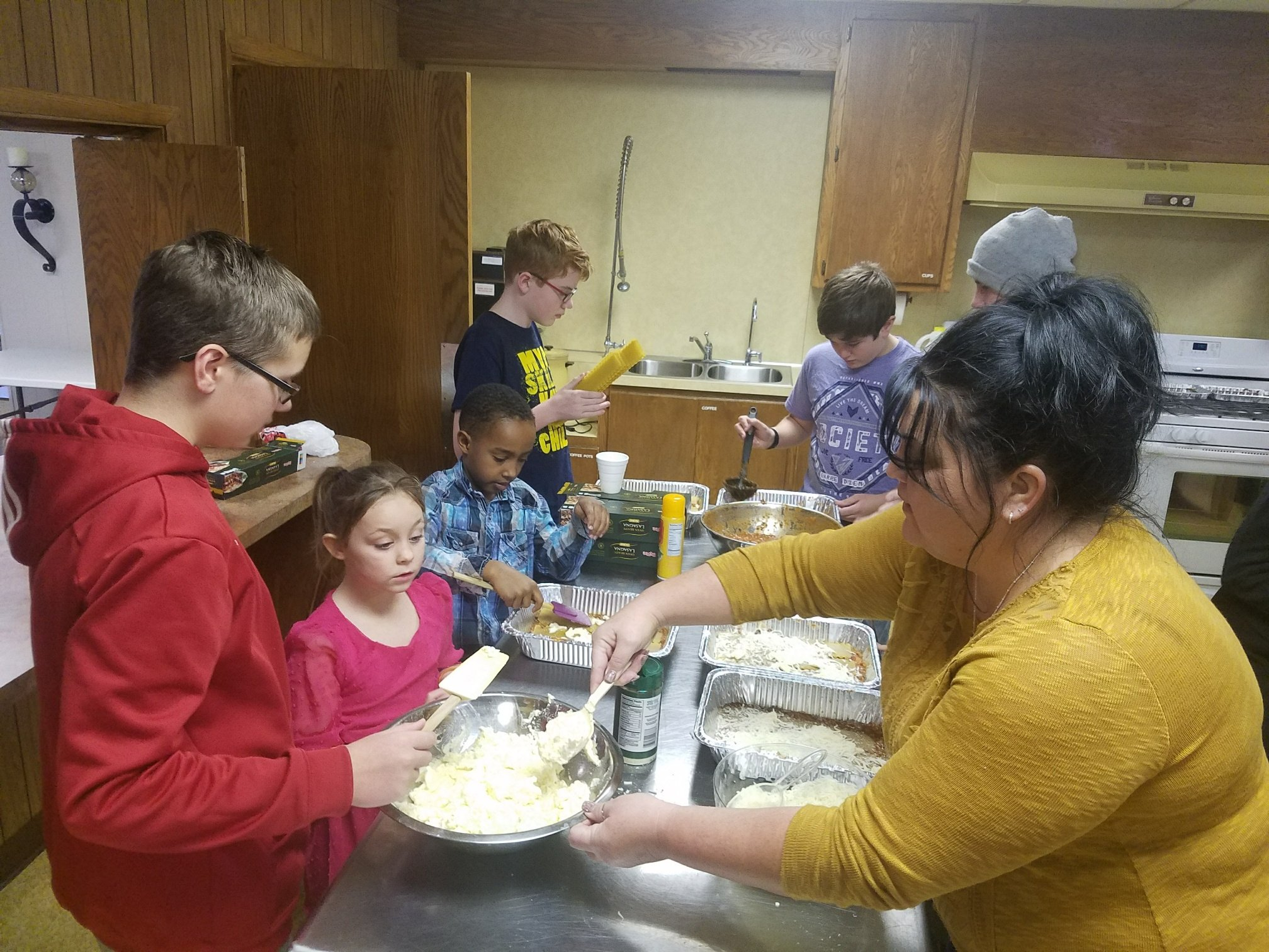 Making lasagna for Beacon of Hope