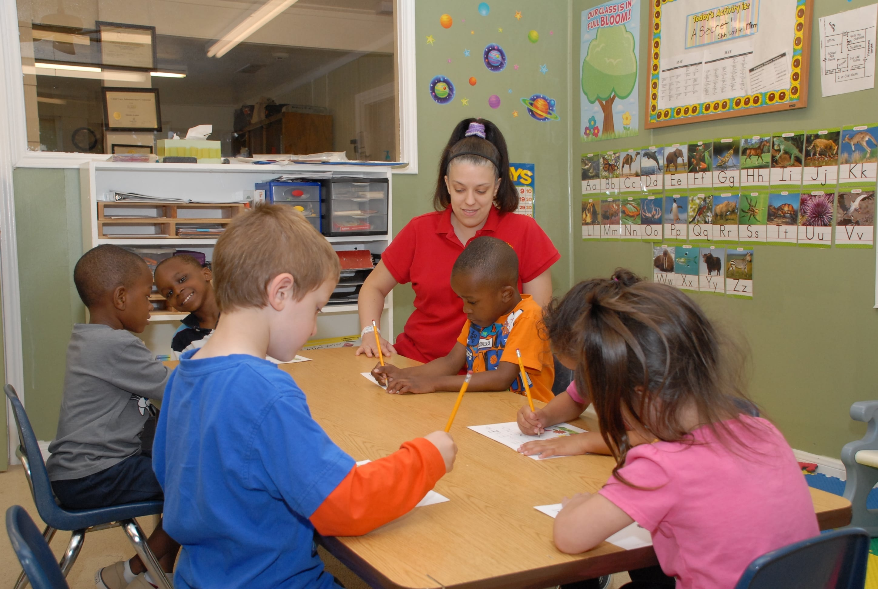 Staff Teaching Children
