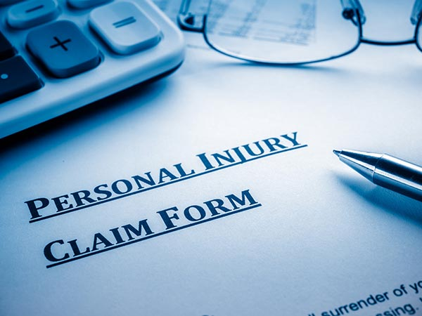 Personal Injury Claim Form On Desk