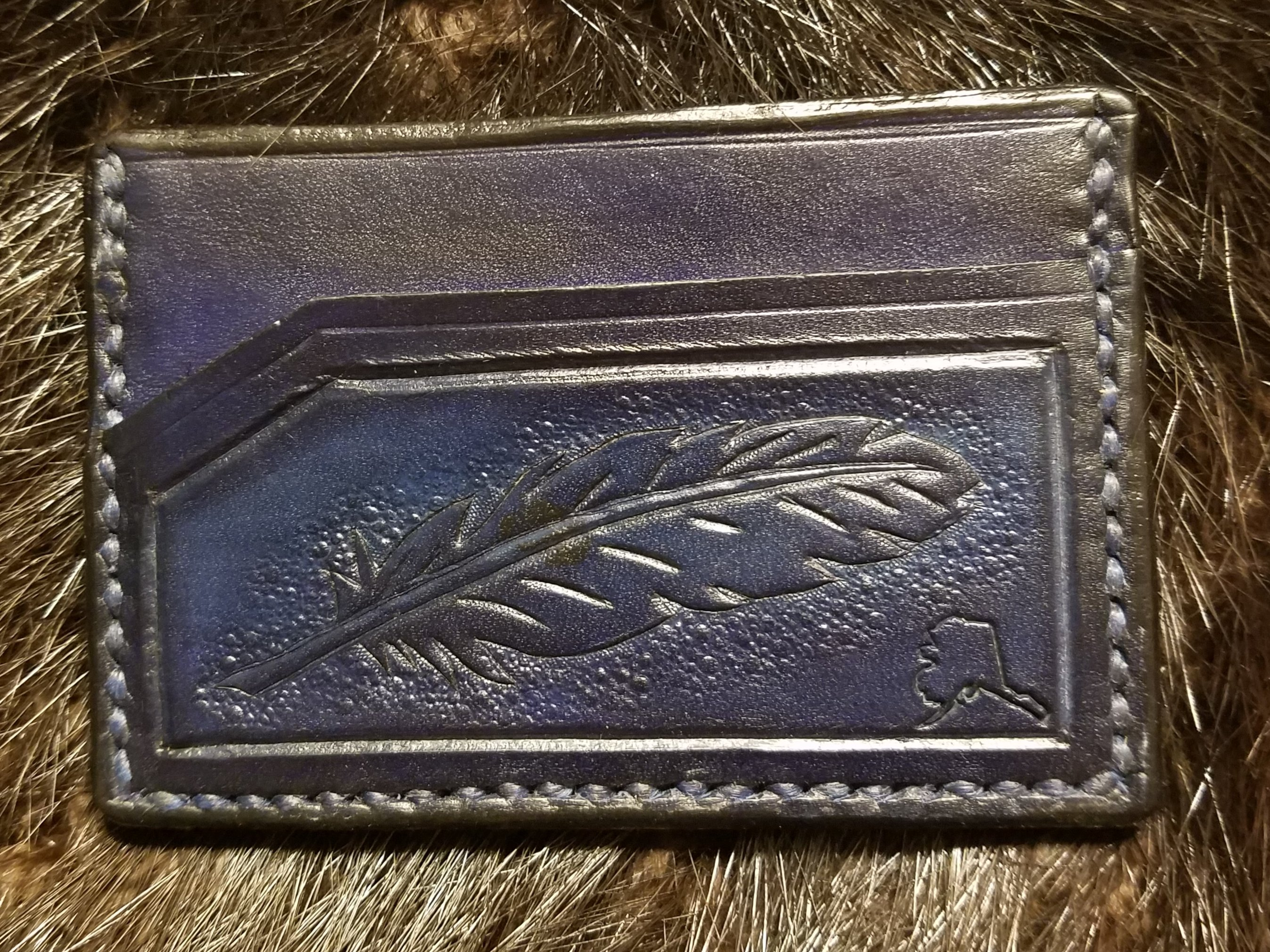 Feather, 3 pocket minimalist wallet, hand tooled and stitched,   $65.00