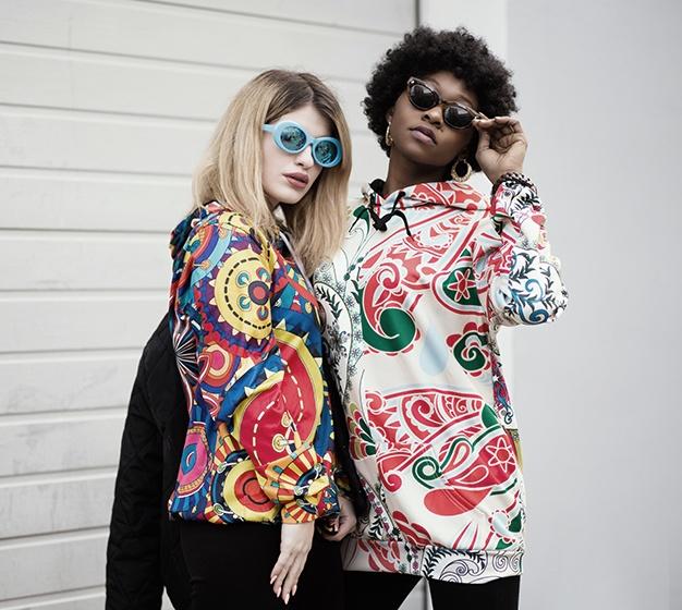 Two Women Standing Near Roller Shutter