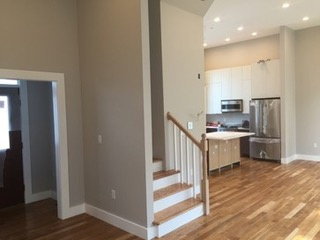 Foyer, family room, and kitchen areas displaying open floor plan.