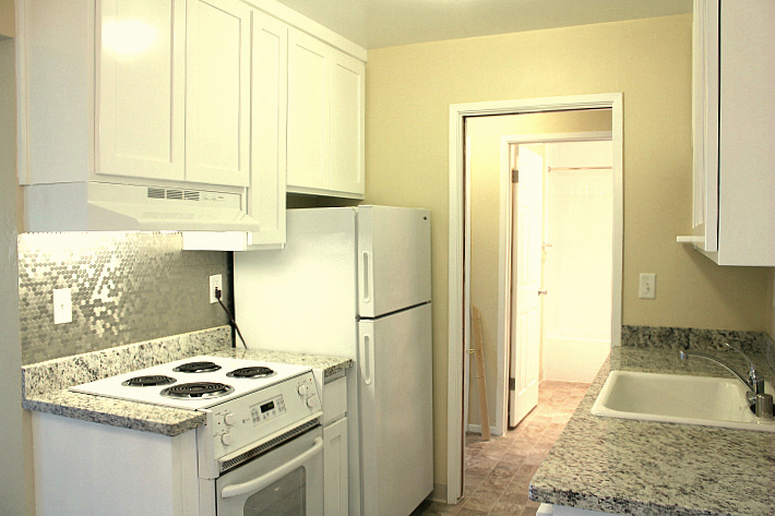 When completed, the kitchen will have new granite countertops and new cabinets, like this apartment.