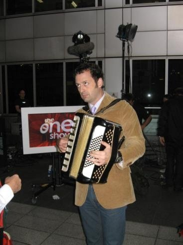 TV presenter Matt Allwright trying to play the accordion