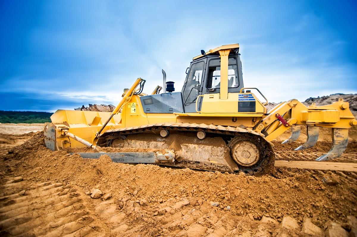 Excavator Removing Dirt on Land
