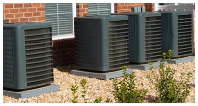 A/C Units Connected to Apartment Building
