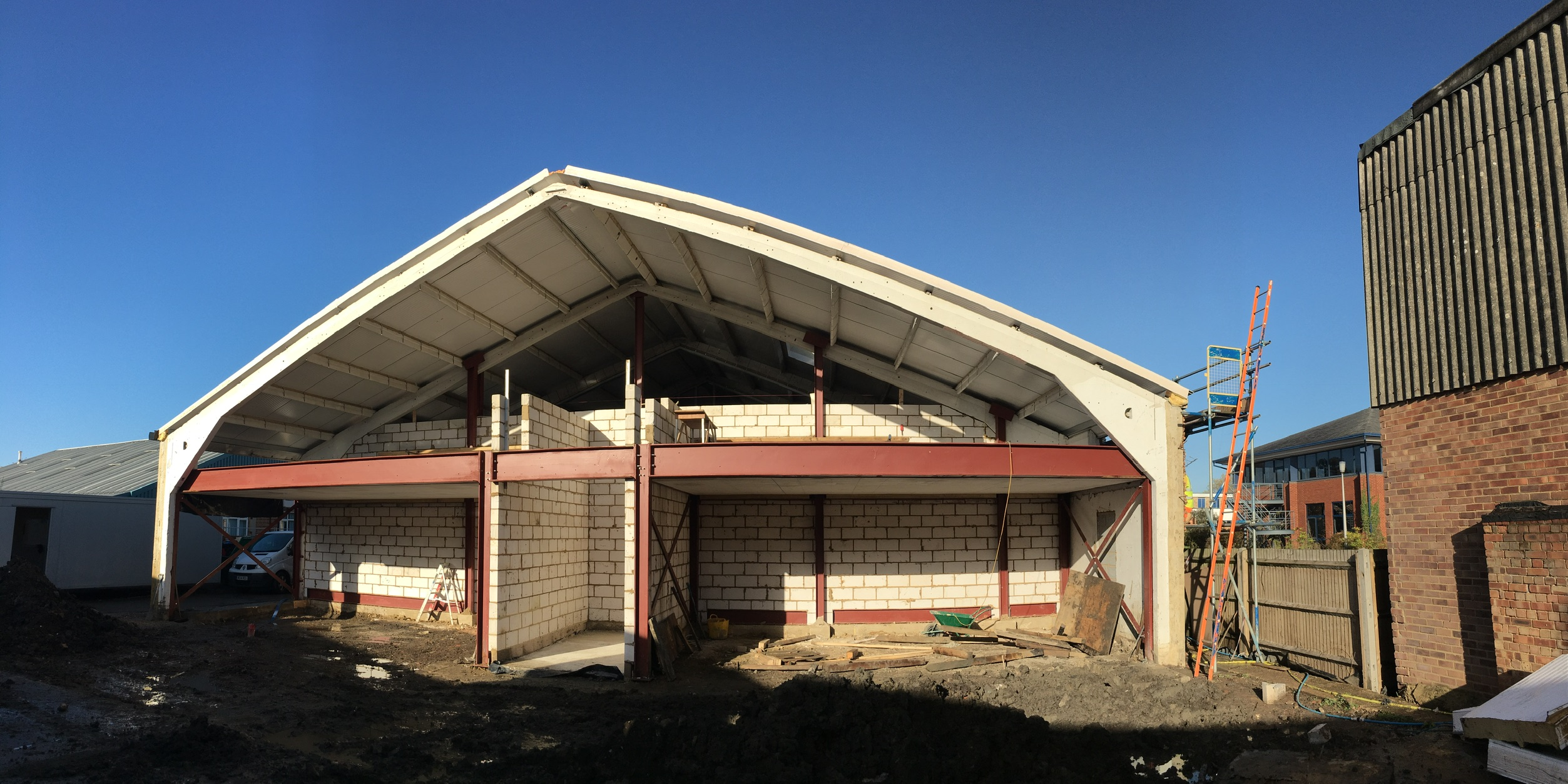 Two offices for the owners with undercroft parking