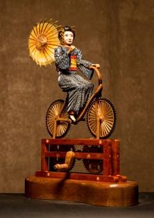 https://0201.nccdn.net/1_2/000/000/0ad/e67/Geisha-en-bicicleta-222x314.jpg