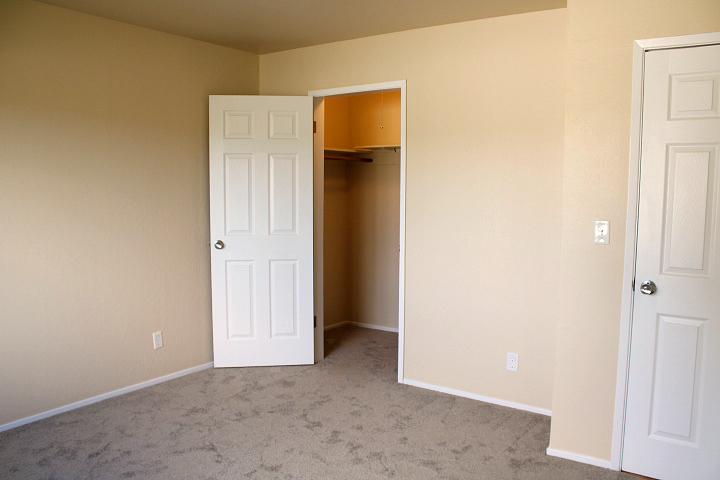 Bedroom with walk-in closet.
