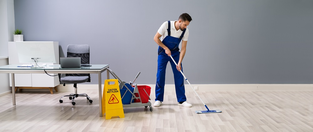 Man Cleaning Floors at Work