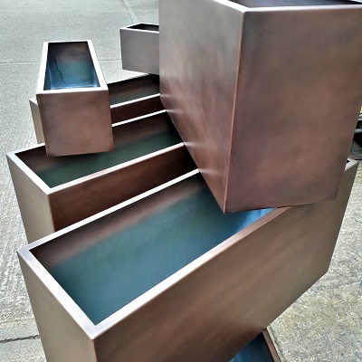 Metal coating projects - bronze finish AM.7 on garden planters.