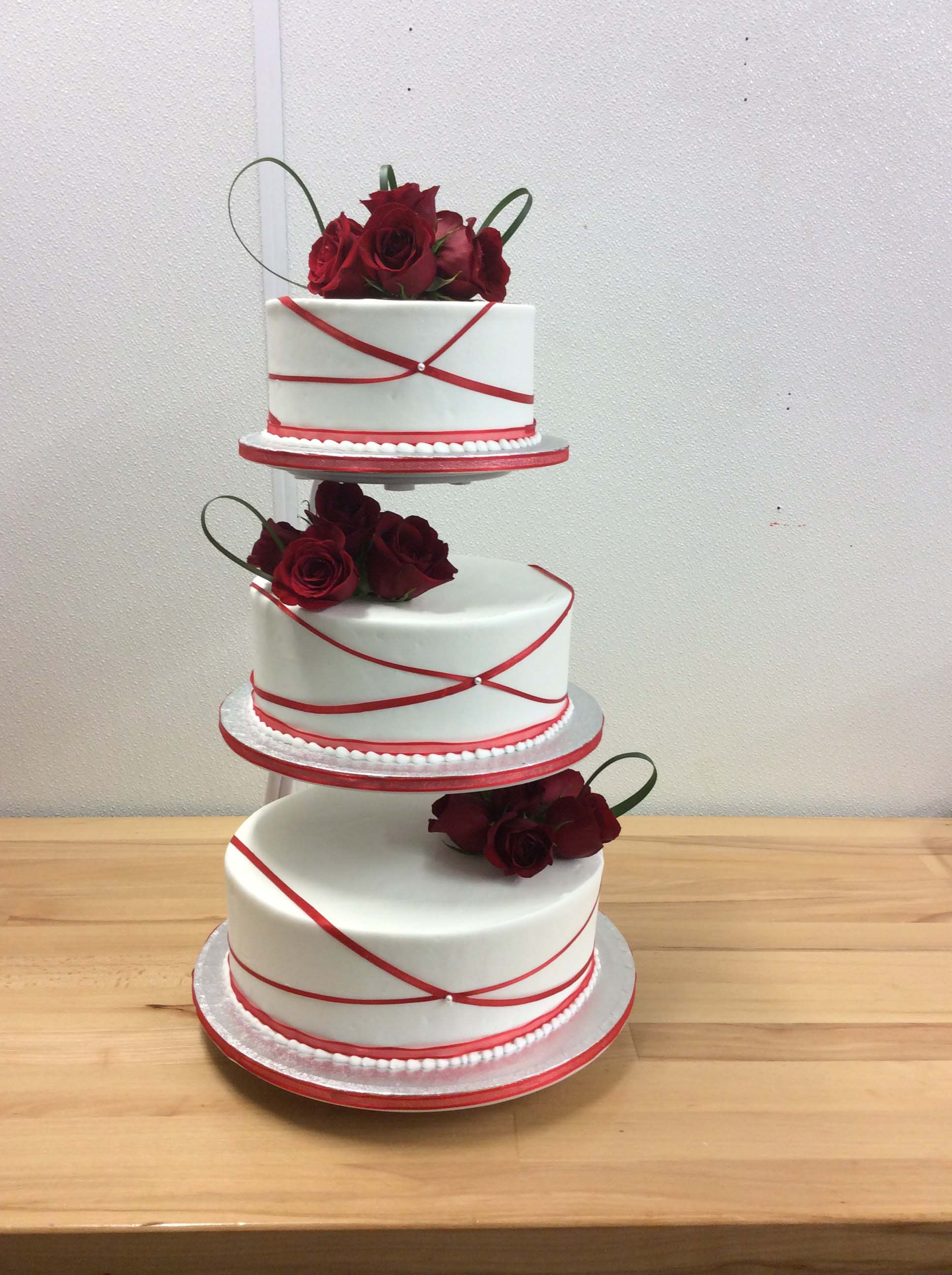 Three-Tier Cake With Red Roses