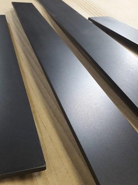 Blackened steel dark patina satin finish Artistic Metals.