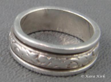 https://0201.nccdn.net/1_2/000/000/0b0/c6e/SS-Spiner-Ring-4x6.jpg