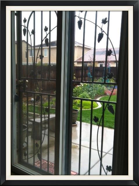 PATIO DOOR GUARD WITH VINES