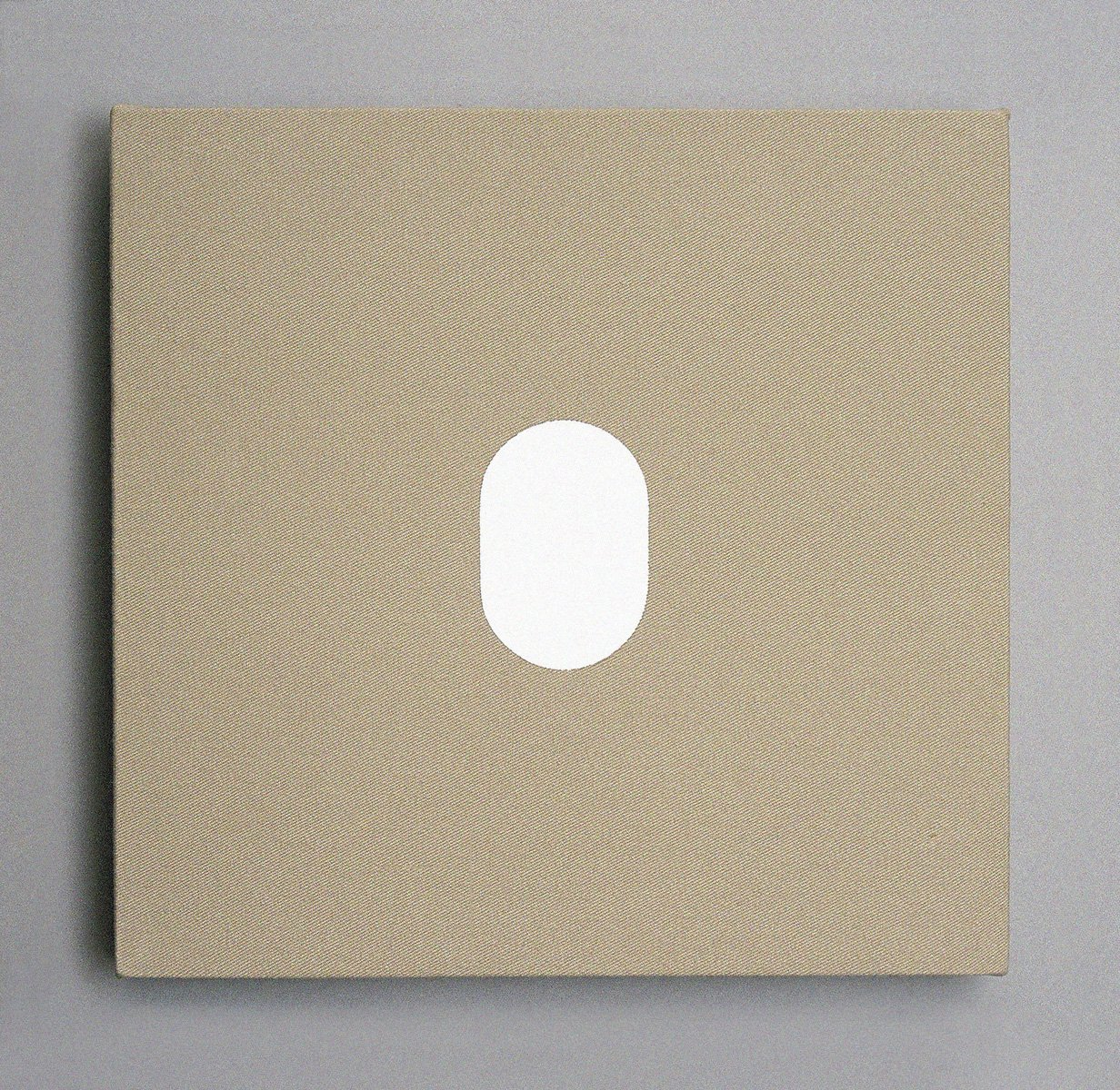 A taupe canvas square with a hard-edge white oval painted in the center.