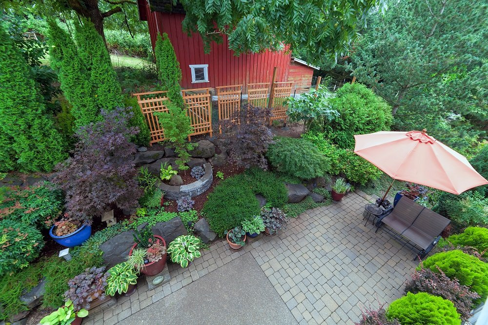 Aerial view of paver patio area with beautiful landscaping